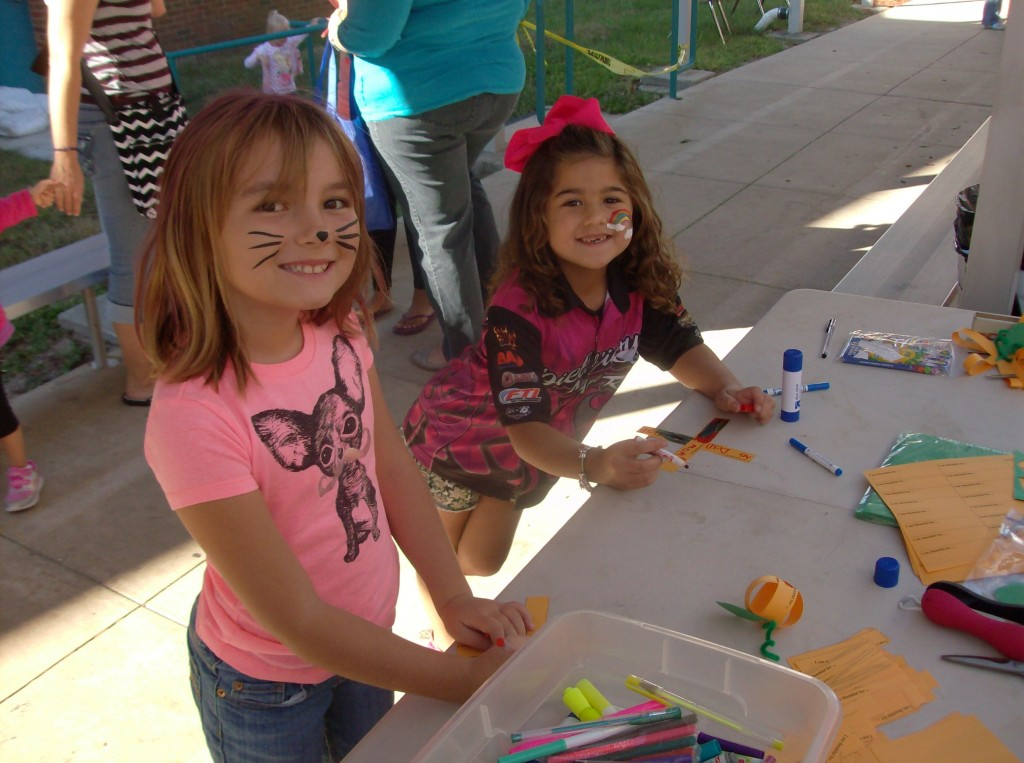 Two young students at an arts and crafts table